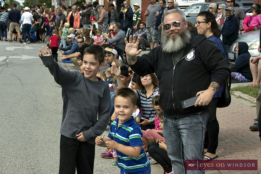 People Waving During The Harrow Fair Parade
