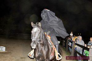 Halloween Spooktakular on The Farm WETRA | The crowd watches as the Headless Horseman rides his horse through the farm yard.
