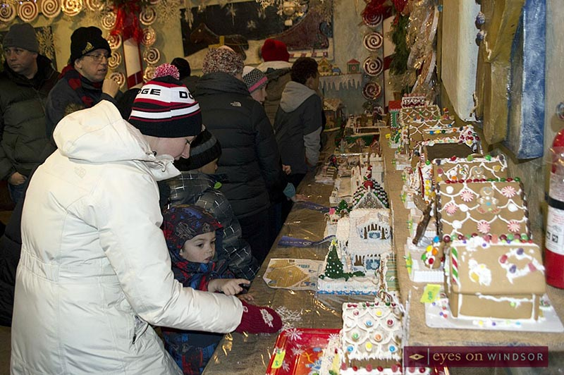 People looking at entries at the Ginger Bread House Competition following the annual Amherstburg Santa Claus Parade inside the Gingerbread Warming House at Toddy Jones Park.