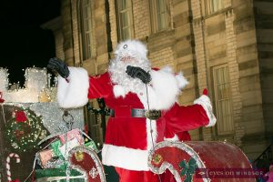Windsor Santa Claus Parade passes by Mackenzie Hall in Old Sandwich Town and Santa and Mrs. Claus wave to the crowd.