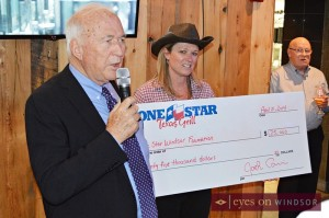 Jack Cowin and Sue Patterson present check to Lone Star Windsor Foundation