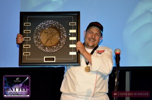 Armando's Marco Maliza displays Battle of the Hors D'oeuvres 2013 Critics Choice Award for best restaurant.