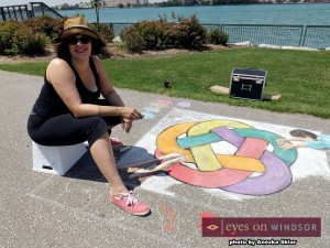 Julie Butler creates chalk drawing of YKNOT logo at Windsor's Social Media Day 2014