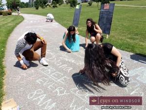 people chalk tweeting for social media day 2014 in Windsor