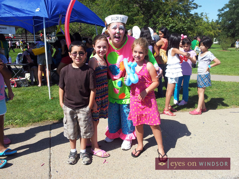 Clown and kids at St. Clair College Family Fun Day.