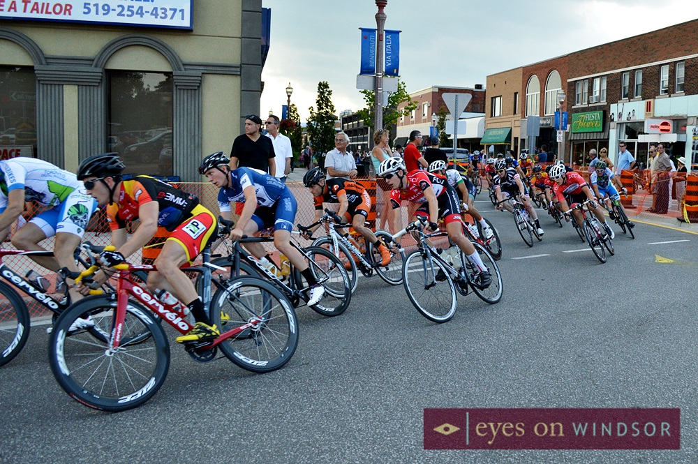 cyclists race around the corner of Erie and Parent.