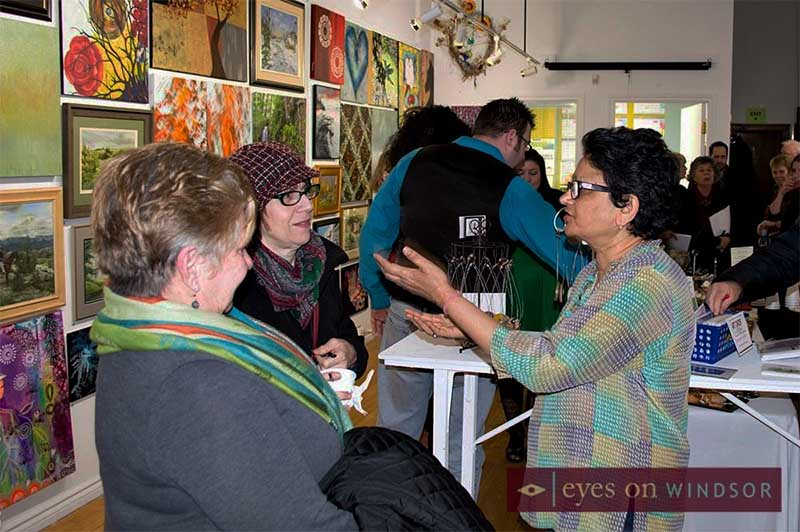 Mixed media artist Rashmi Dadwal at Mistletoe & Snow: Members Holiday Art Show and Sale exhibit reception at ArtSpeak Gallery