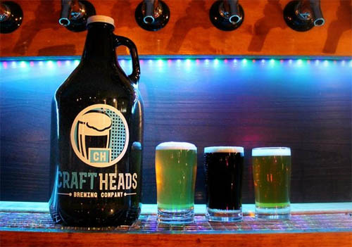 Craft Heads Brewing Company Growler and glasses of craft beer on display.
