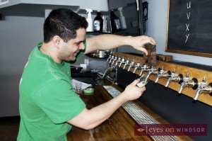 Steve Fabischek pours a glass of craft beer.