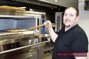 Marco Malizia cooking pizza at his new restaurant.