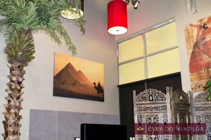 decor at Sarai, pictured here paintings and palm tree.
