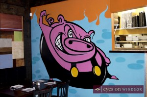 Snackbar-b-q wall mural with a pig flexing