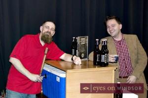 head brewer Paul Brady serving sample of barrel aged coffee porter to Jon Liedtke