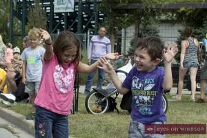 children having fun at Tecumseh Corn Festival Parade