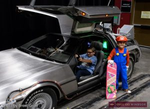 Young boys at Windsor ComiCon sit in The DeLorean Time Machine from Back to the Future