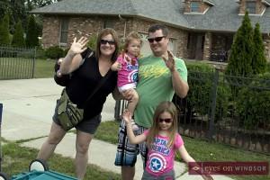 Family having fun at Tecumseh Corn Fest parade.