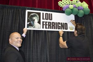Jeremy Renaud holds sign as Lou Ferrigno autographs it at Windsor ComiCon