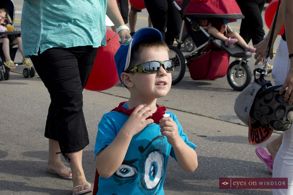 Young boy marches in Labour Day Parade.