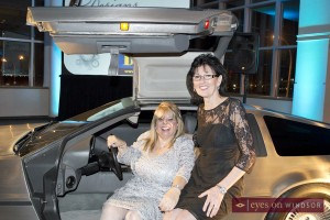 Deborah Jones sits in DeLorean Time Machine with owner Diane