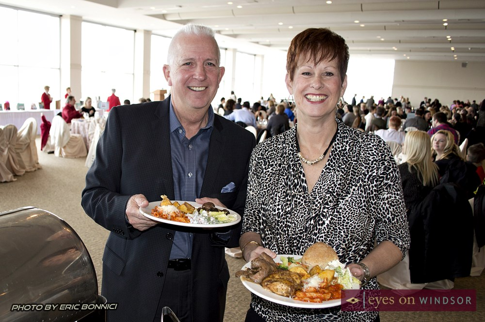Guests smiling as the enjoy their breakfast brunch buffet.