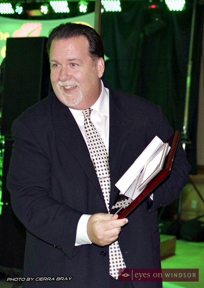 John Fairley receives community recognition award.