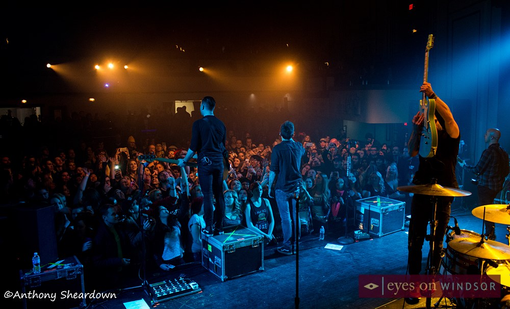 Shot of Simple Plan and the crowd of fans cheering at the Olde Walkerville Theatre.