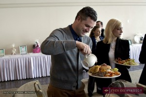 Jason Toner pours maple syrup over his breakfast at Chocolate Lovers Brunch.