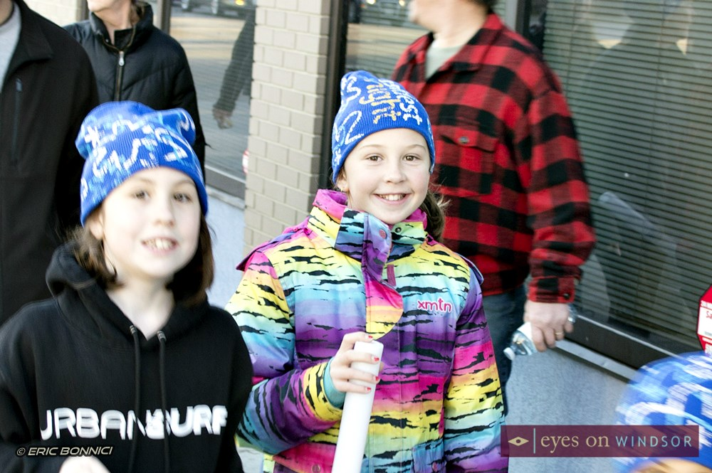 Children in downtown Windsor Ontario walking during The Coldest Night of The Year Walk.