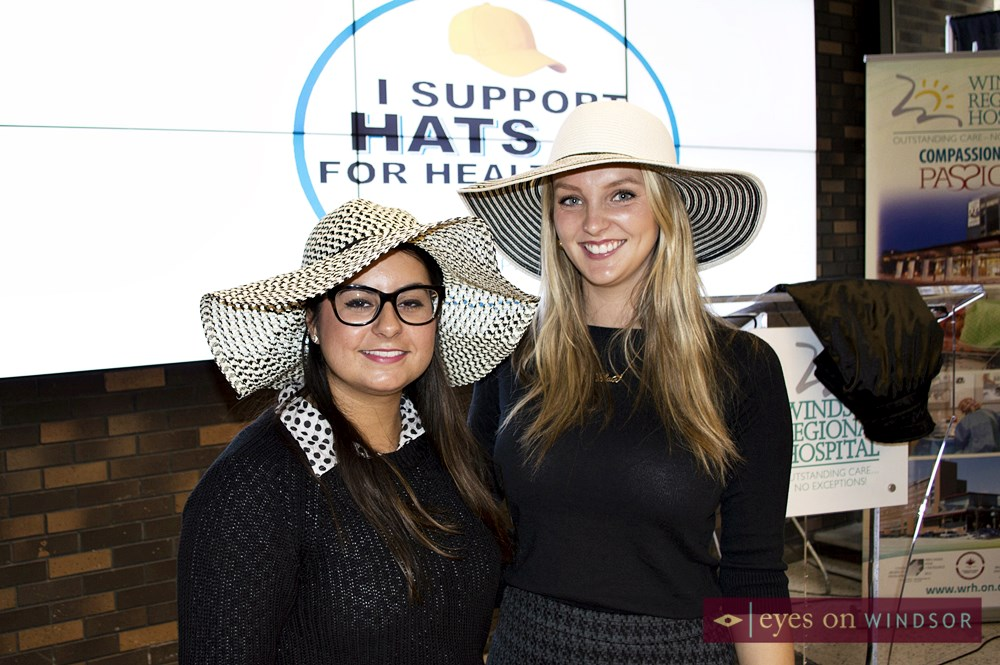 young ladies wearing hats during launch.