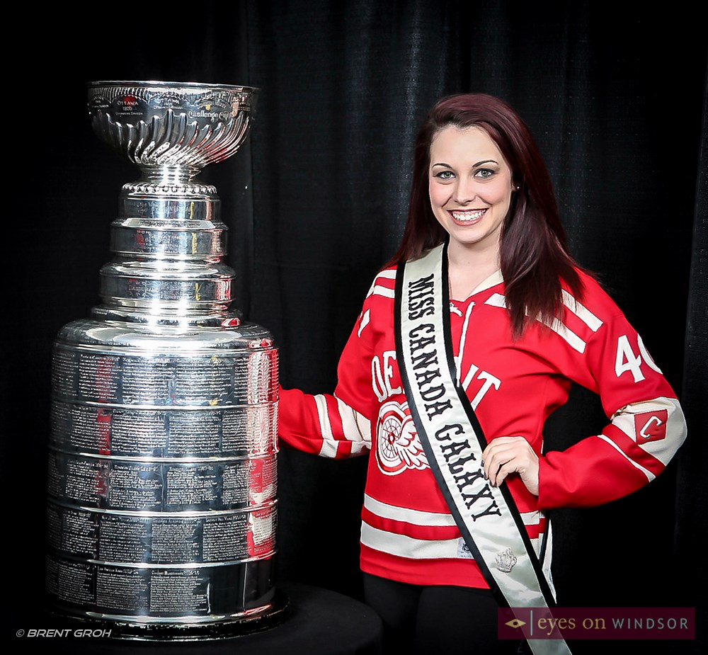 Miss Galaxy Canada Jillian Parent poses with the Stanley Cup at Windsor Spitfires Game.