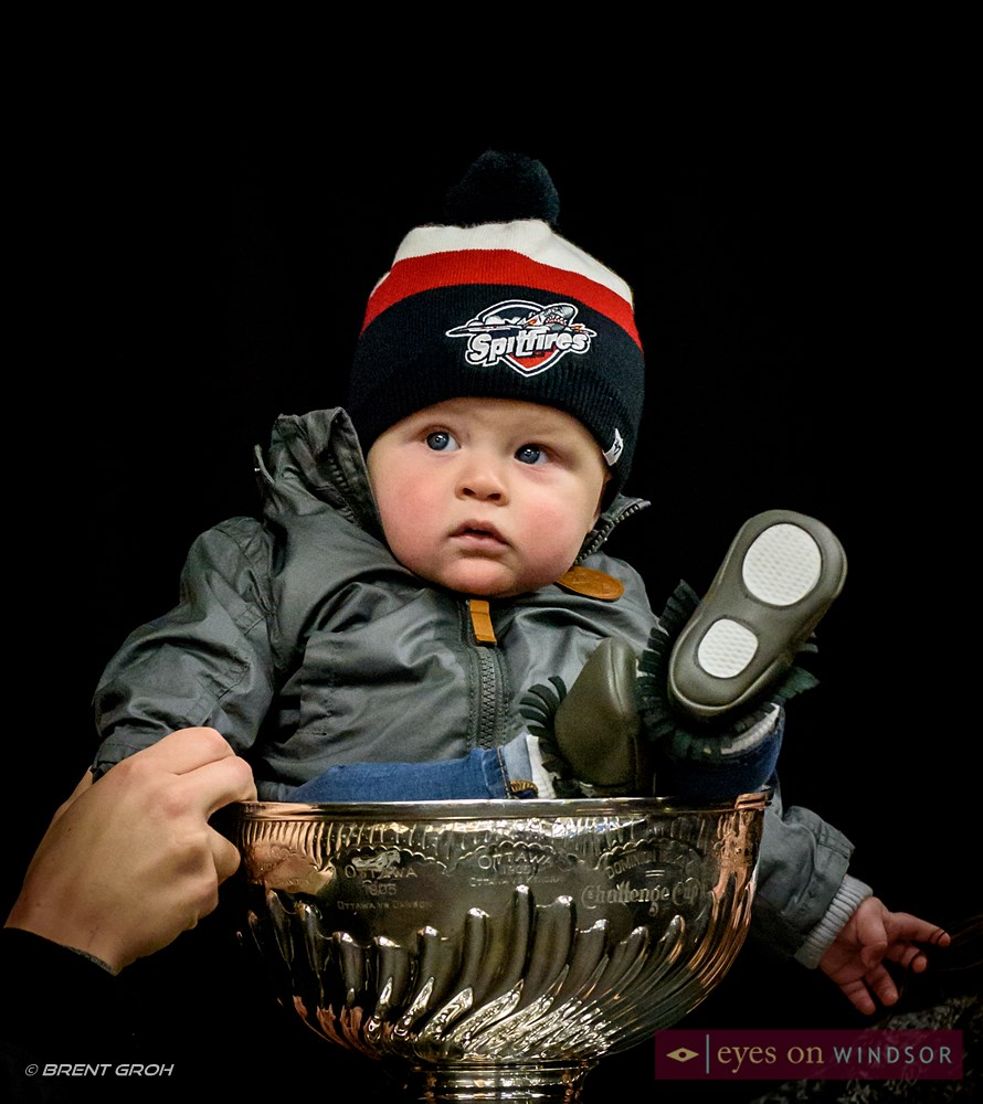 Cohen Thibert sits in the Stanley Cup.