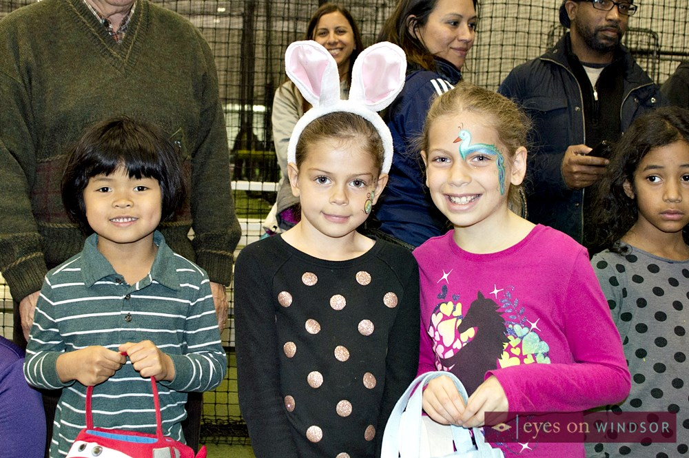 Children with face painted getting ready for Easter Egg Hunt.