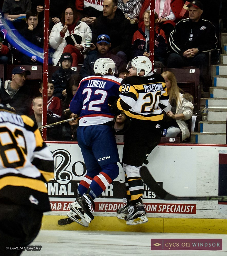 Windsor Spitfires Brendan Lemieux collides mid air with Roland McKeown of the Kingston Frontenacs.