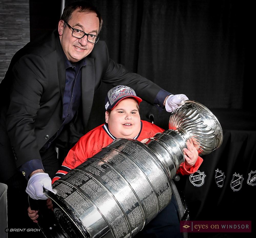 Sammy Uprichard holds the Stanley Cup.