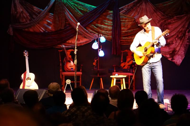 Dave Gunning performs in front of a sold out crowd at the Bank Theatre during Road to Kingsville Folk Music Festival Concert Series.