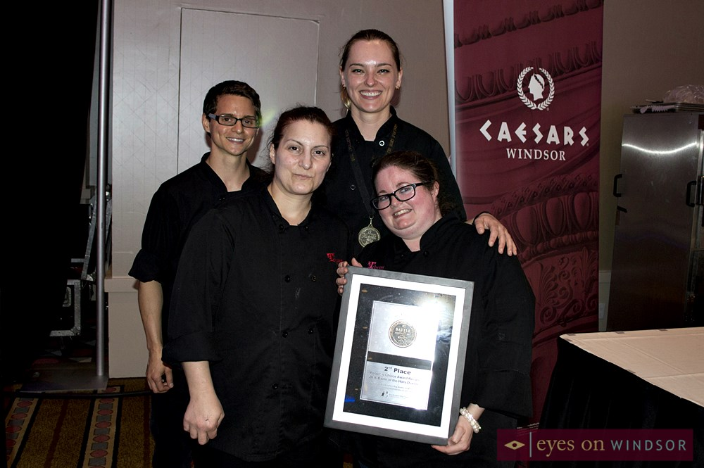 Julie Myers and her team from Thyme to Go holding People's Choice Award.