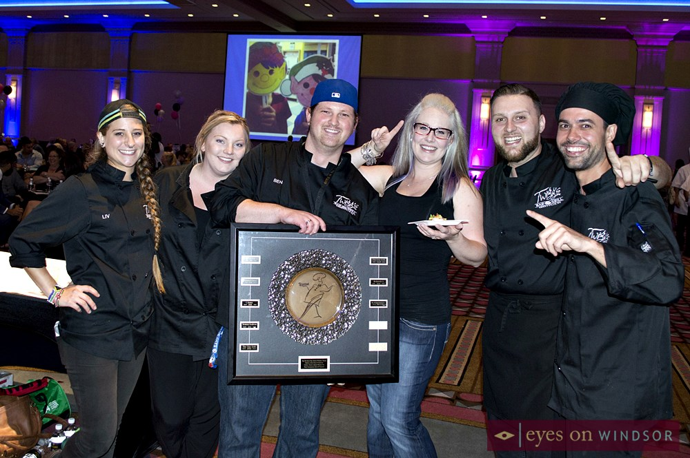 Culinary team from Twiggs Bar & Grill hold up award.
