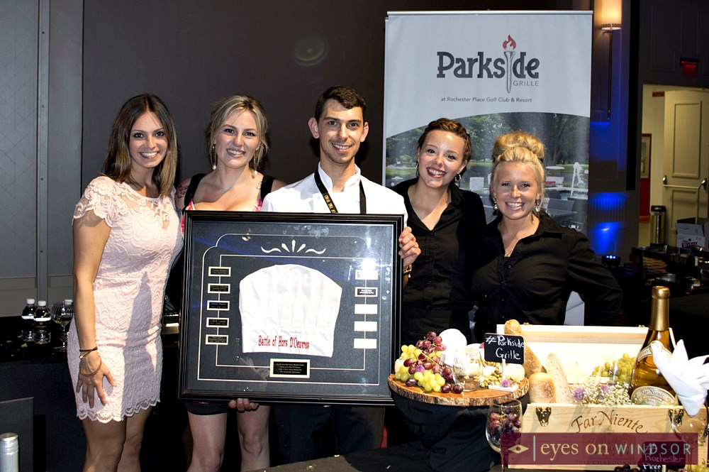 Parkside Grille at Rochester Place holding award.