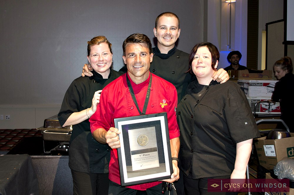 Just Jeff's Gourmet Express holding award.