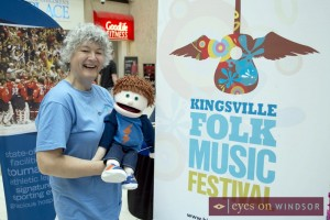 Jan Hall of Folk Roots Radio with her puppet at the Kingsville Folk Music Festival Staycation Expo exhibit.