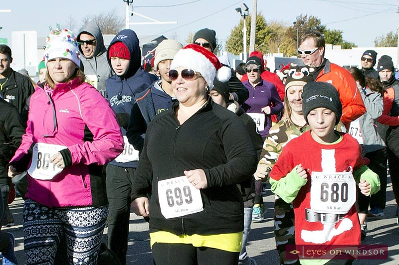 Family running during the Jingle Bell Run, Walk & Wheel