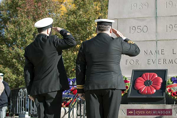Military members salute wreaths at City of Windsor Memorial Cenotaph on Remembrance Day.