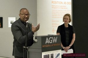Dr. Kenneth Montague speaks about the Wedge collection at the Art Gallery of Windsor during a press conference. In the background is Dr. Catharine Mastin.