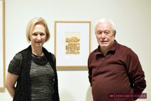 Dr. Catharine Mastin, AGW Director & Curator stands with printmaker/artist Elio Del Col with his Olde Sandwich Towne print on display at the Local Matters exhibit.