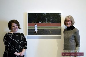 Suzy Lake with one of her photographs and AGW curator Jaclyn Meloche.