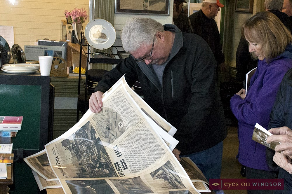 People look at old newspaper stories about Essex Railway Station explosions.