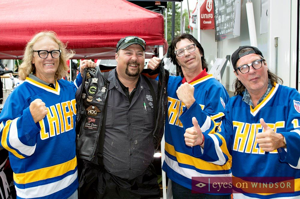 Hanson Brothers grab motorcyclist by the vest during Bob Probert Ride launch.