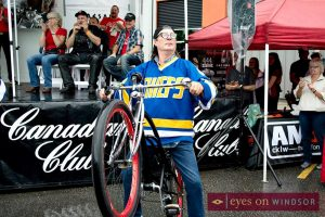 Hanson Brother pops a wheelie on his vintage bicycle during the Bob Probert Ride launch.