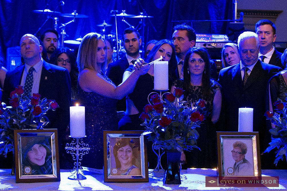 Families lighting candles in tribute to lost loved ones during In Honour of The Ones We Love Gala