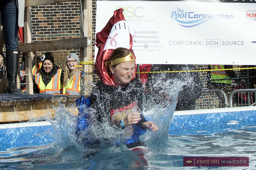 Polar Plunger dresses as super hero jumps into pool.